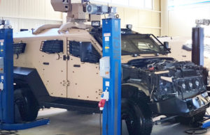 Sand-cat vehicle during maintenance in Plasan service center